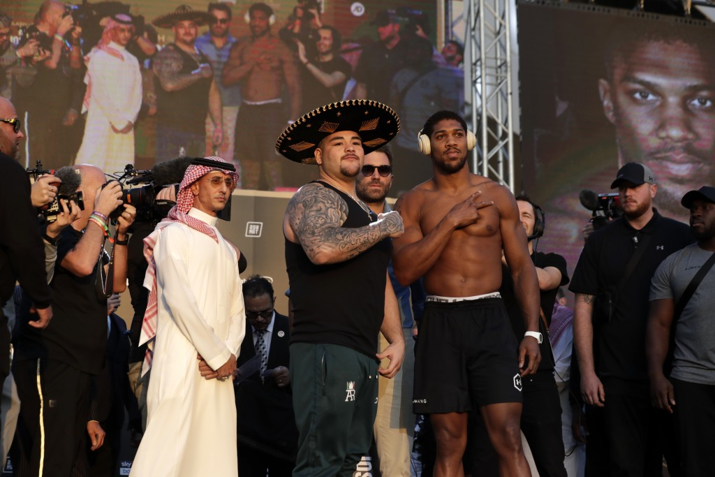 Heavyweight boxers Anthony Joshua of Britain, right, and Andy Ruiz Jr. of Mexico pose during a weigh-in at Faisaliah Center, in Riyadh, Saudi Arabia, ...