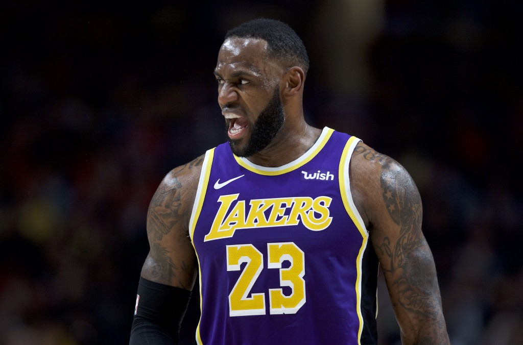 Los Angeles Lakers forward LeBron James reacts after scoring against the Portland Trail Blazers during the first half of an NBA basketball game in Por...