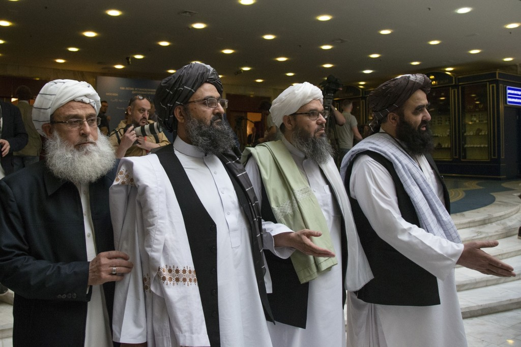 FILE - In this May 28, 2019, file photo, Mullah Abdul Ghani Baradar, the Taliban group's top political leader, second left, arrives with other members...