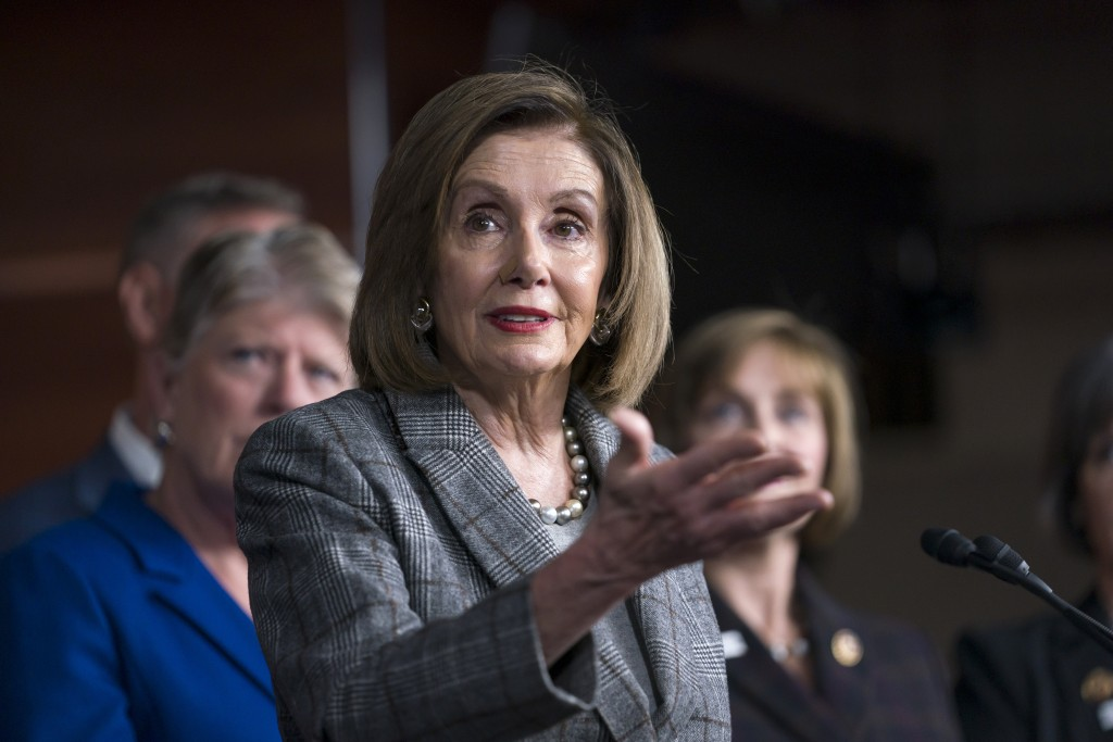 Speaker of the House Nancy Pelosi, D-Calif., discusses her recent visit to the UN Climate Change Conference in Madrid, Spain, during a news conference...