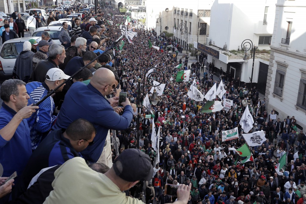 People take snapshot of a gathering against the government and the upcoming presidential elections in Algiers, Algeria, Friday, Dec. 6, 2019. Thousand...