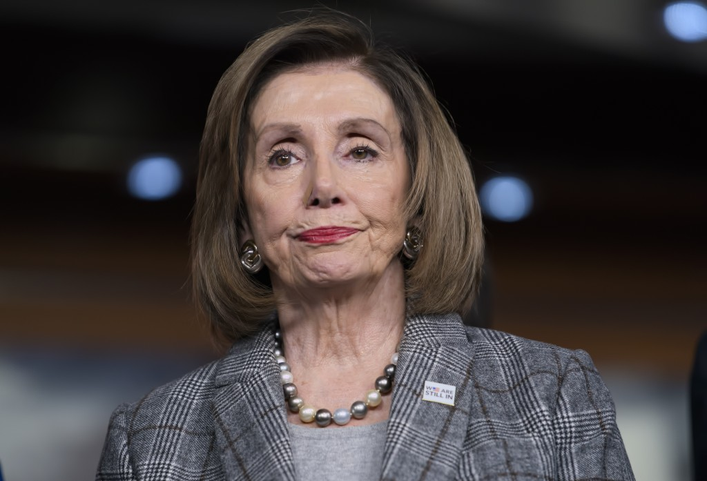 Speaker of the House Nancy Pelosi, D-Calif., stands during a news conference on climate change at the Capitol in Washington, Friday, Dec. 6, 2019. Hou...