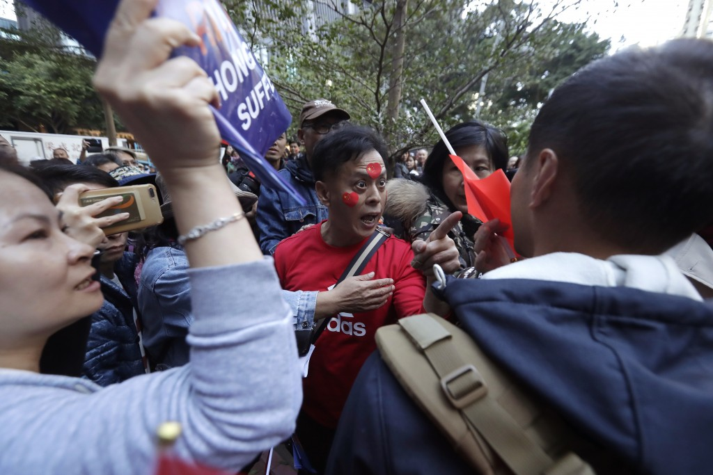 A pro-Beijing supporter yells at a photographer during a rally in Hong Kong on Saturday, Dec. 7, 2019. Six months of unrest have tipped Hong Kong's al...