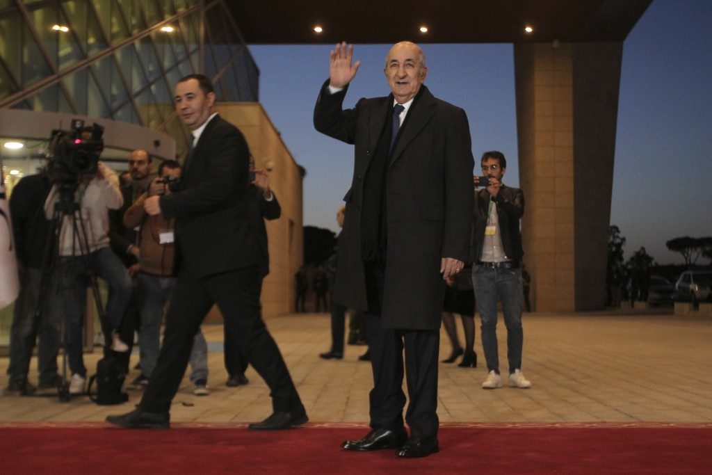 Algerian presidential candidate Abdelmadjid Tebboune arrives for televised debate in Algiers, Friday, Dec. 6, 2019. Restive Algeria is holding its fir...