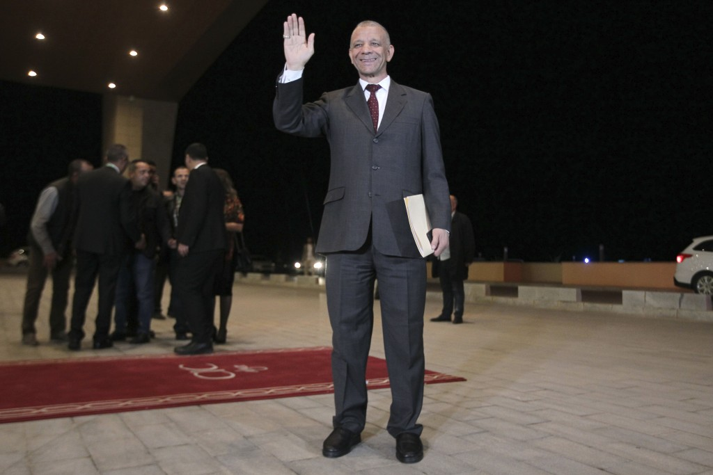 Algerian presidential candidate Abdelkader Bengrina arrives for televised debate in Algiers, Friday, Dec. 6, 2019. Restive Algeria is holding its firs...