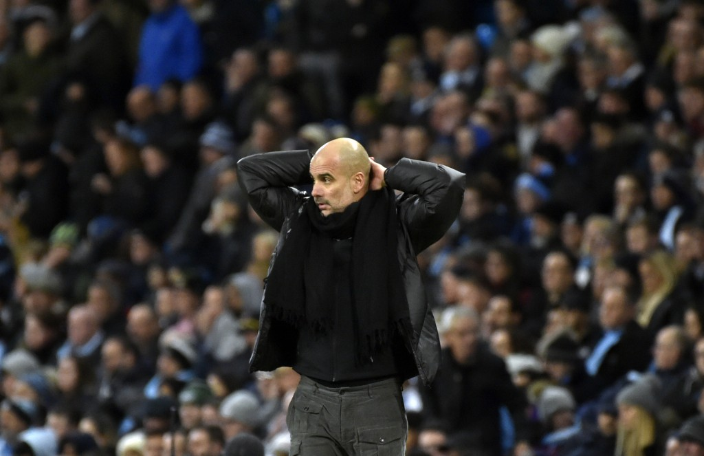 Manchester City's head coach Pep Guardiola reacts during the English Premier League soccer match between Manchester City and Manchester United at Etih...