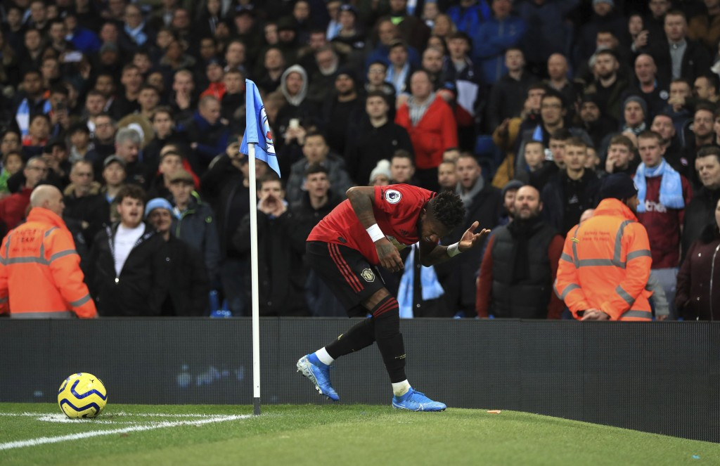 Manchester United's Fred reacts after objects are thrown at him during the English Premier League soccer match at the Etihad Stadium, Manchester, Engl...