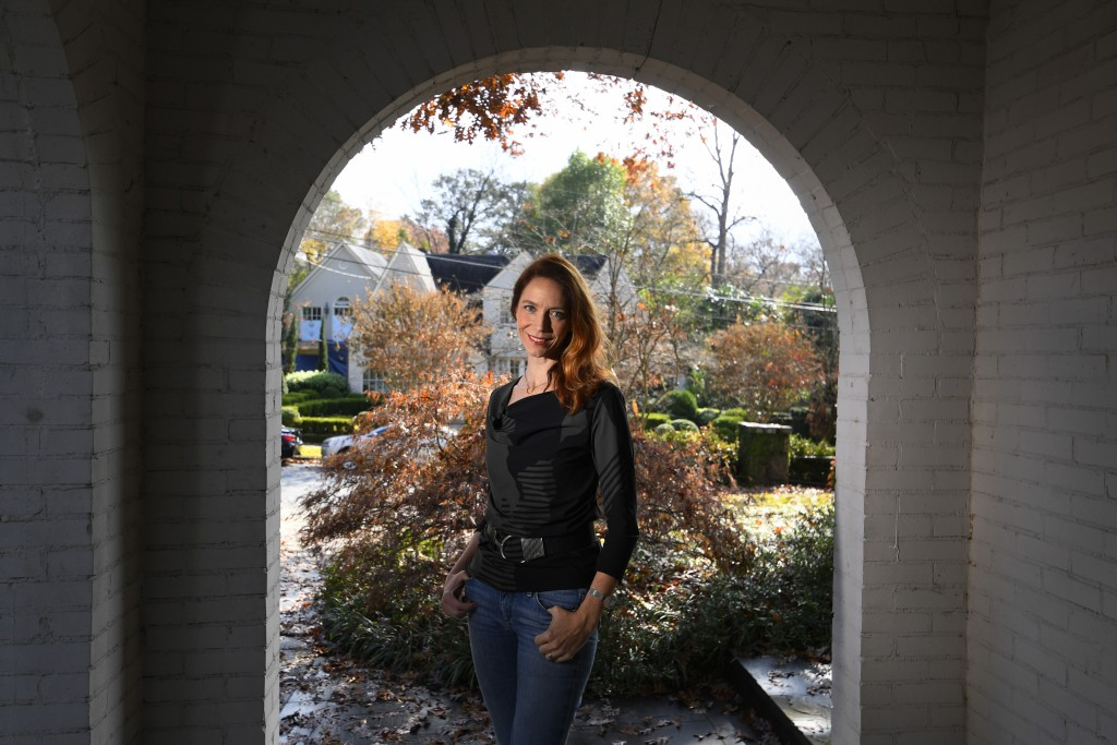 In this Nov. 27, 2019, photo, Georgia Tech professor Kim Cobb poses for a photo at her home in Atlanta. Some climate scientists and activists, includi...