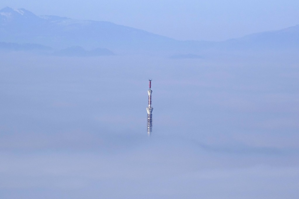 A TV tower is surrounded by fog in Sarajevo, Sunday, Dec. 8, 2019. The local government in Sarajevo issued a warning to residents to avoid spending ti...