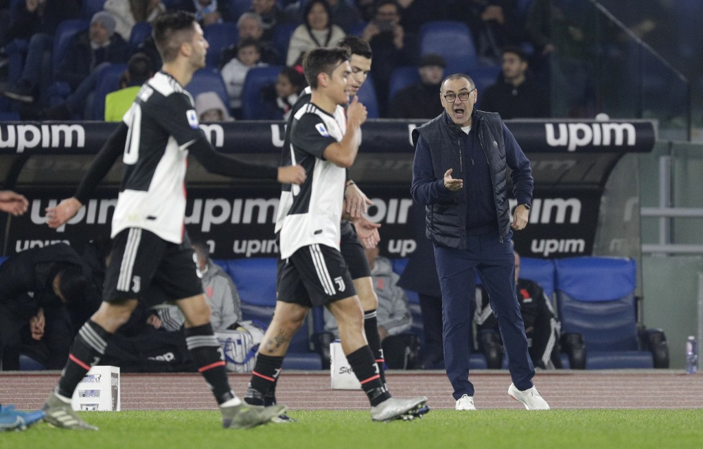 Juventus' head coach Maurizio Sarri, right, gives instructions from the side line during the Italian Serie A soccer match between Lazio and Juventus a...