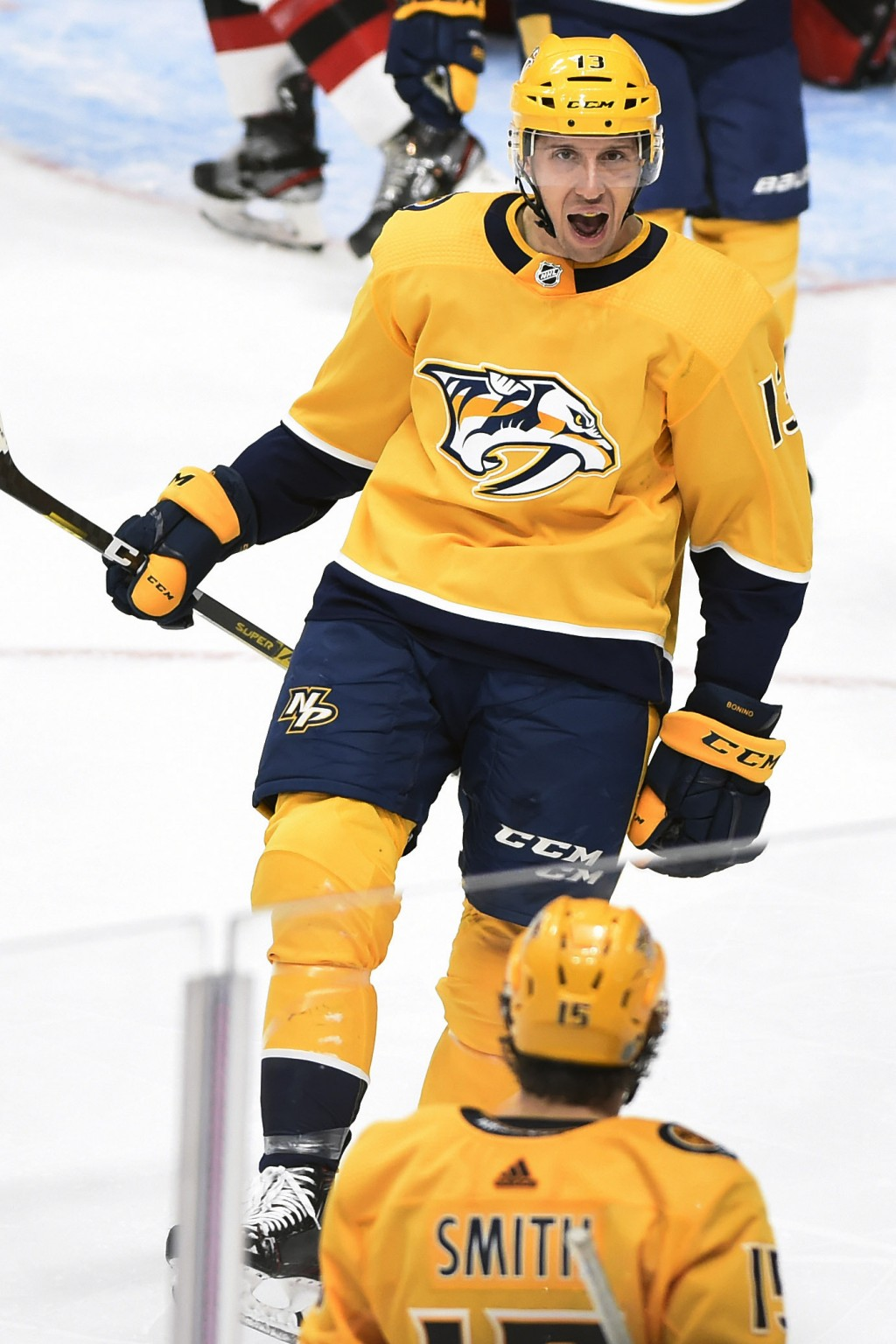 Nashville Predators center Nick Bonino (13) celebrates with right wing Craig Smith (15) after Bonino scored against the New Jersey Devils during the t...