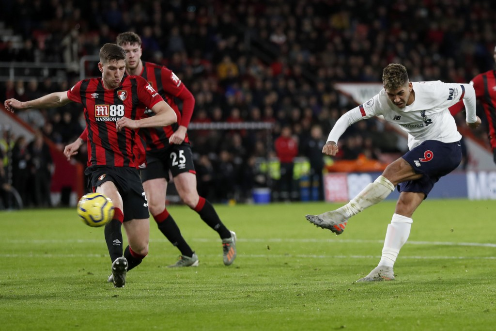 Liverpool's Roberto Firmino shoots but fails to score during the English Premier League soccer match between Bournemouth and Liverpool at the Vitality...