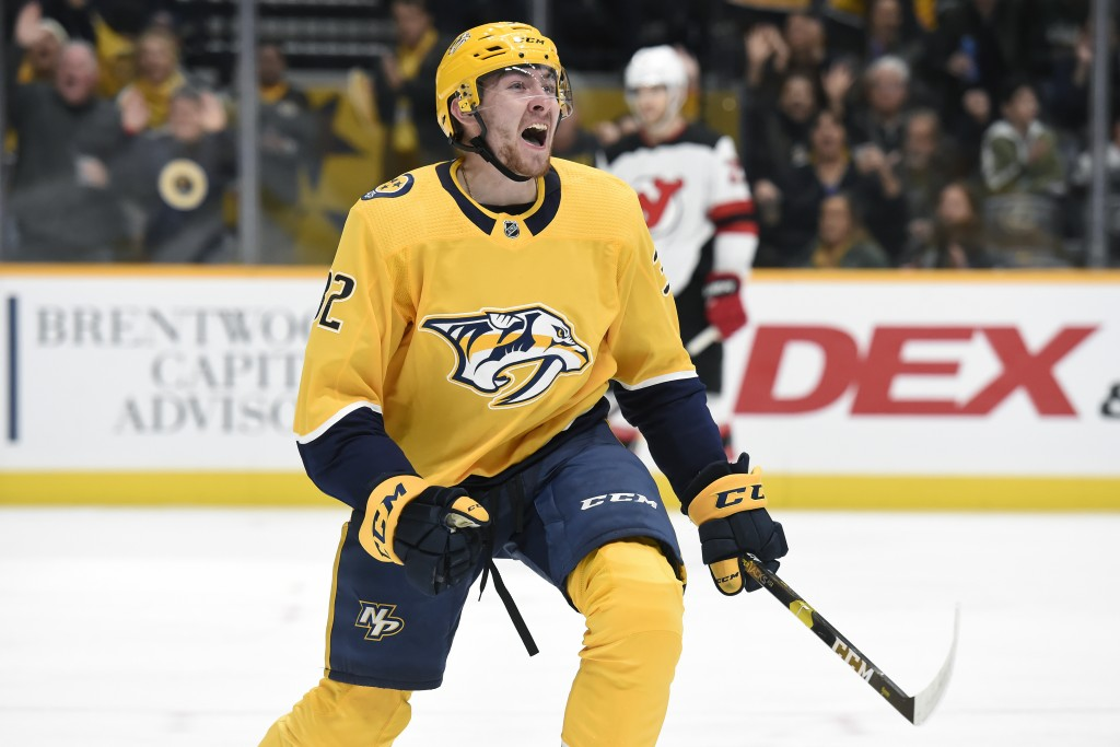 Nashville Predators center Yakov Trenin (32), of Russia, celebrates after scoring against the New Jersey Devils during the second period of an NHL hoc...