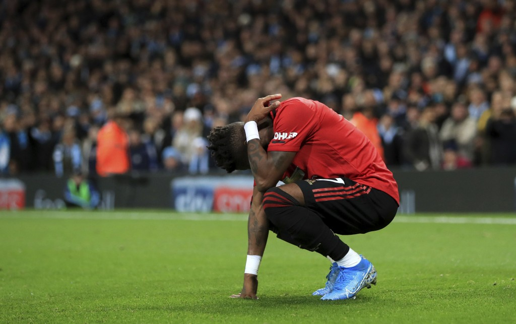 Manchester United's Fred reacts after objects were thrown at him during the English Premier League soccer match at the Etihad Stadium, Manchester, Eng...