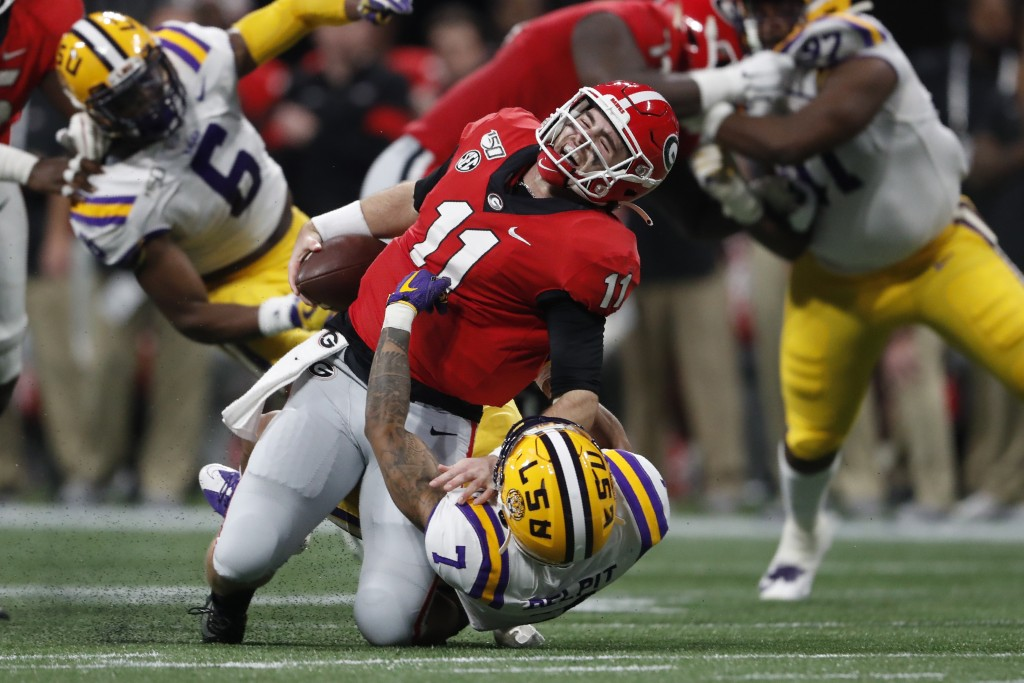 LSU safety Grant Delpit (7) sacks Georgia quarterback Jake Fromm (11) during the first half of the Southeastern Conference championship NCAA college f...