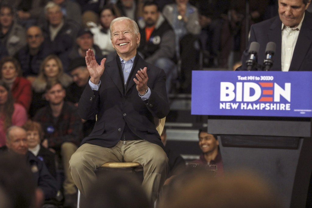 Democratic presidential candidate and former Vice President Joe Biden reacts while John Kerry, the former secretary of state and 2004 Democratic presi...