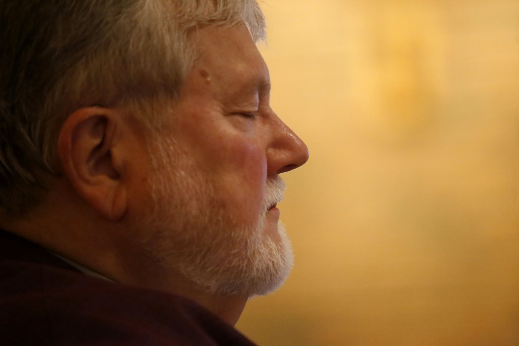 In this Sunday, Dec. 1, 2019 photo, Rev. Philip Schmitter meditates before preparing for a celebration of Mass at Christ the King Catholic Church in F...