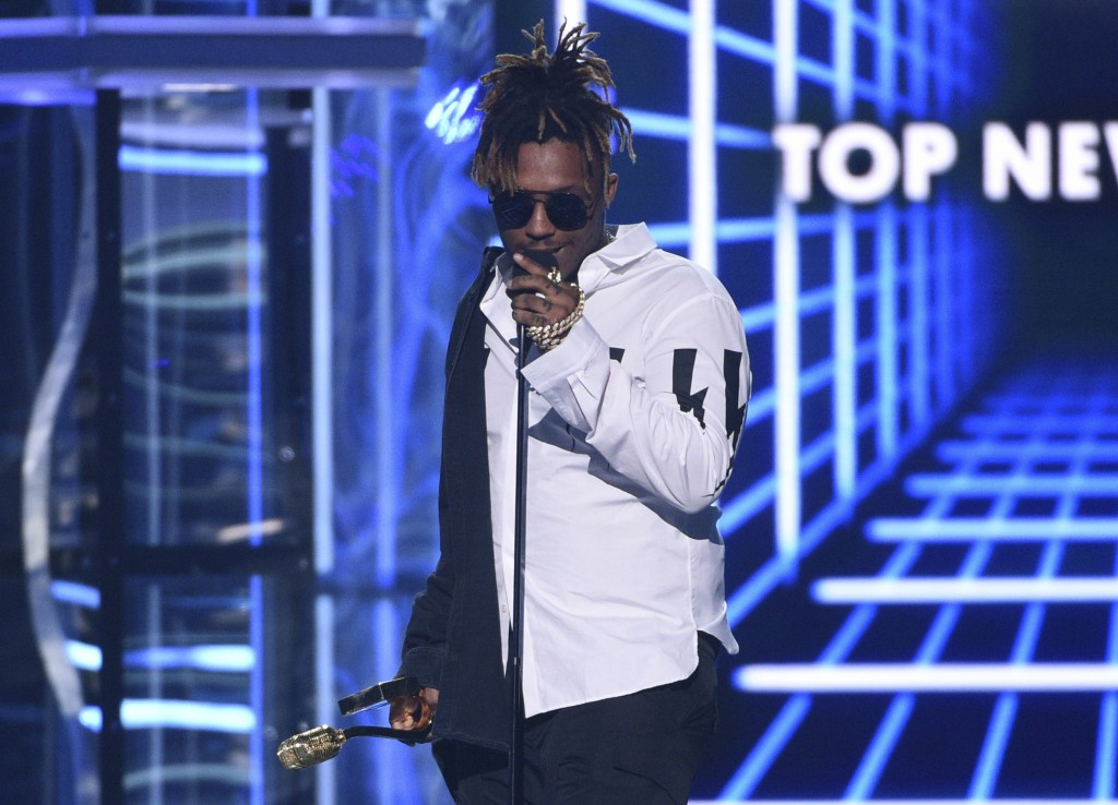 FILE - In this May 1, 2019 file photo, Juice WRLD accepts the award for top new artist at the Billboard Music Awards at the MGM Grand Garden Arena in ...