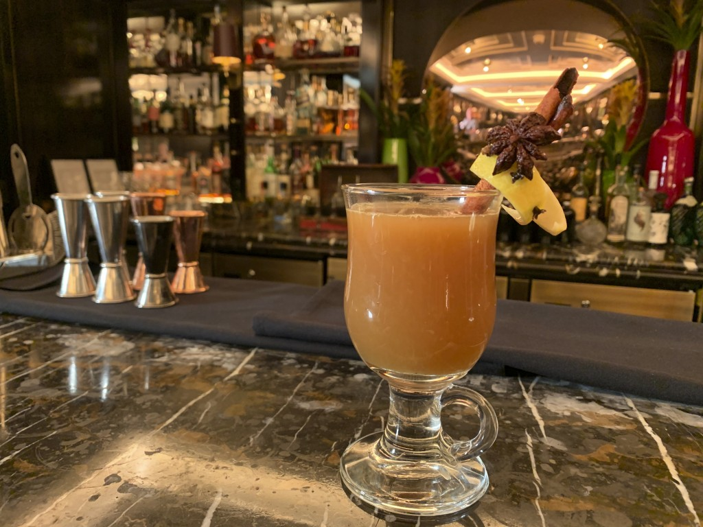 In this Wednesday, Dec. 4, 2019 photo, the wassail cocktail is displayed at the Manetta's Bar in Flemings Mayfair Hotel in London.  While mulled wine,...
