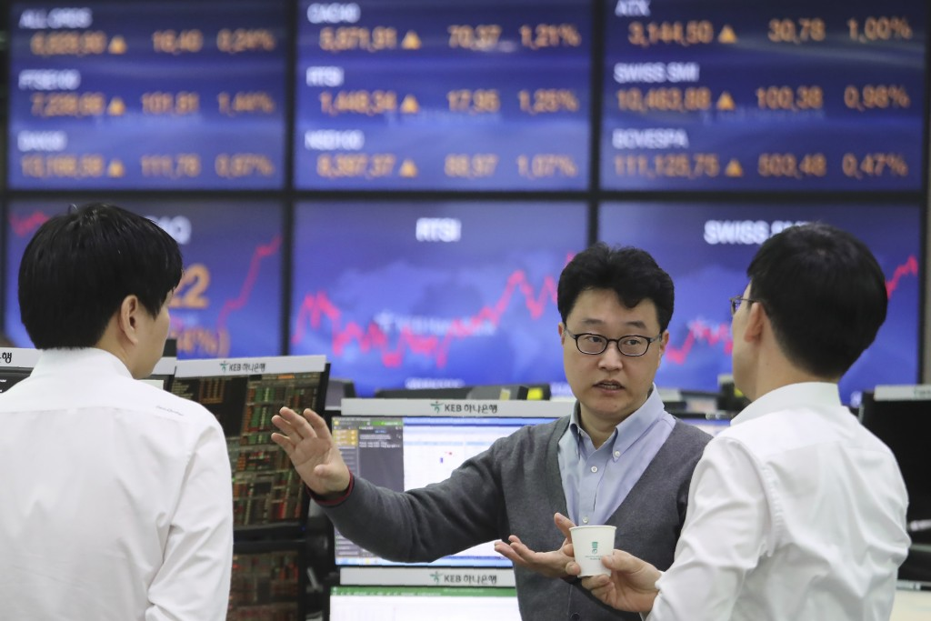 Currency traders work at the foreign exchange dealing room of the KEB Hana Bank headquarters in Seoul, South Korea, Monday, Dec. 9, 2019. Asian shares...