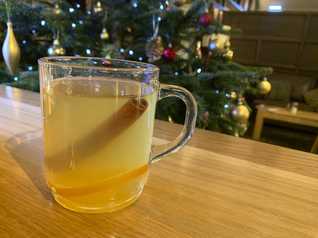 In this Wednesday, Dec. 4, 2019 photo, a traditional hot toddy is displayed at the Dewar's Aberfeldy in London.  While mulled wine, warm spiced cider ...