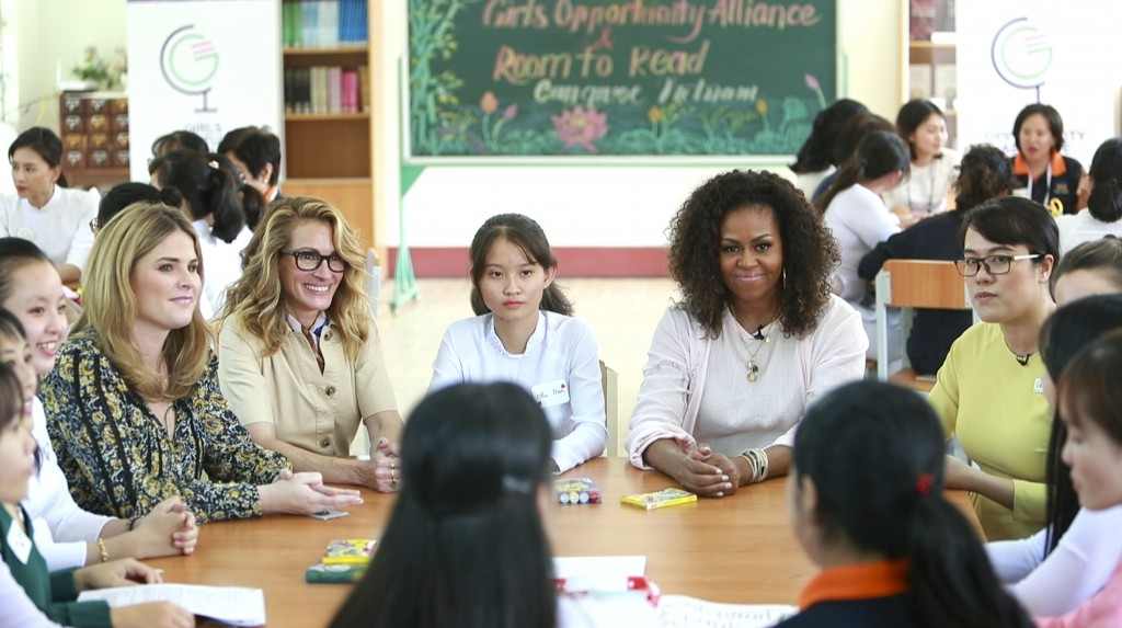 Former U.S. fist lady Michelle Obama, actress Julia Roberts, fifth left, and Jenna Bush Hager, fourth left, talk with female students at the Can Giuoc...