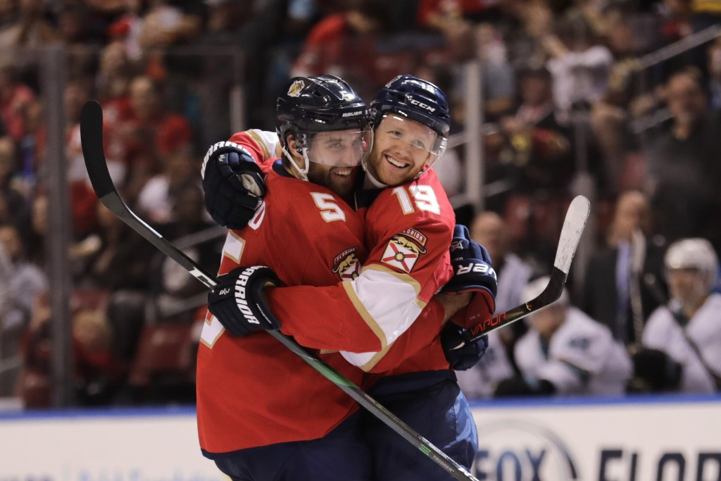 Florida Panthers' Mike Matheson (19) celebrates with teammate Aaron Ekblad (5) after scoring a goal during the second period of an NHL hockey game aga...