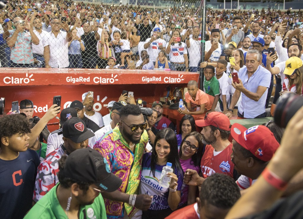 Legendary Boston Red Sox slugger David Ortiz greets fans after making a surprise appearance at the Day of Legends baseball event at the Quisqueya Stad...