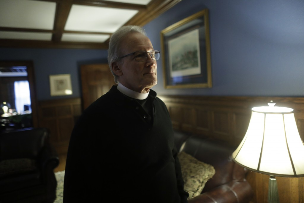 In this Sunday, Oct. 20, 2019 photo Rev. William Tourigny, center, pastor of St. Rose de Lima Parish, in Chicopee, Mass., speaks with a reporter from ...