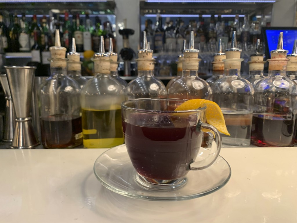 In this Wednesday, Dec. 4, 2019 photo a warm winter bishop cocktail is displayed at the Swift cocktail bar in London,  While mulled wine, warm spiced ...