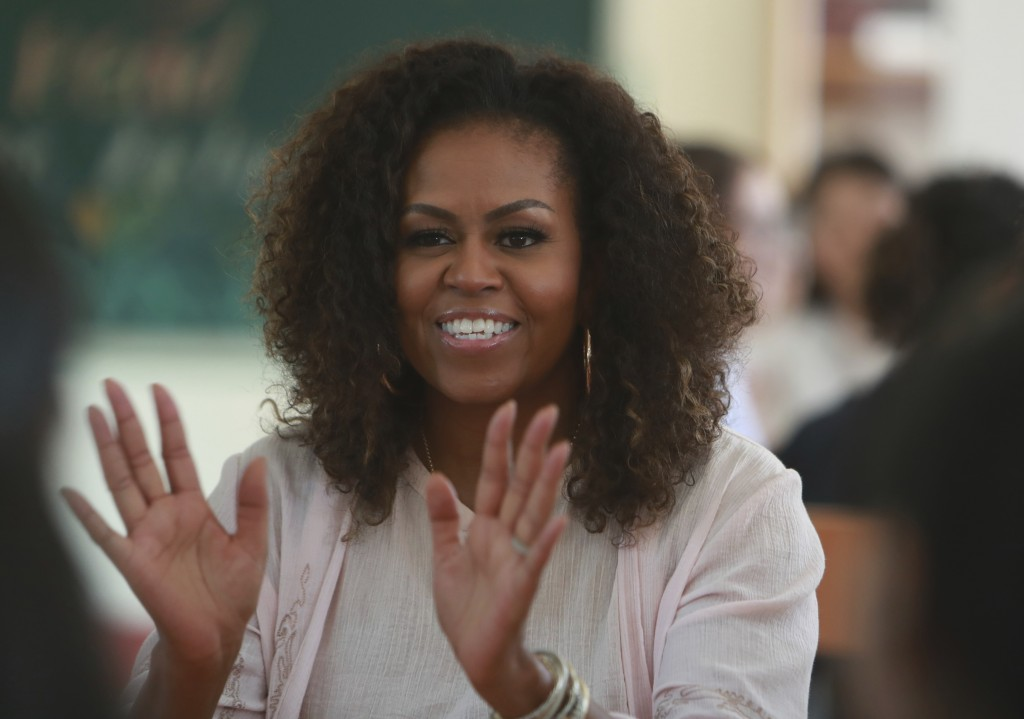 Former U.S. first lady Michelle Obama speaks to female students at the Can Giuoc high school in Long An province, Vietnam, Monday, Dec. 9, 2019. Mrs. ...