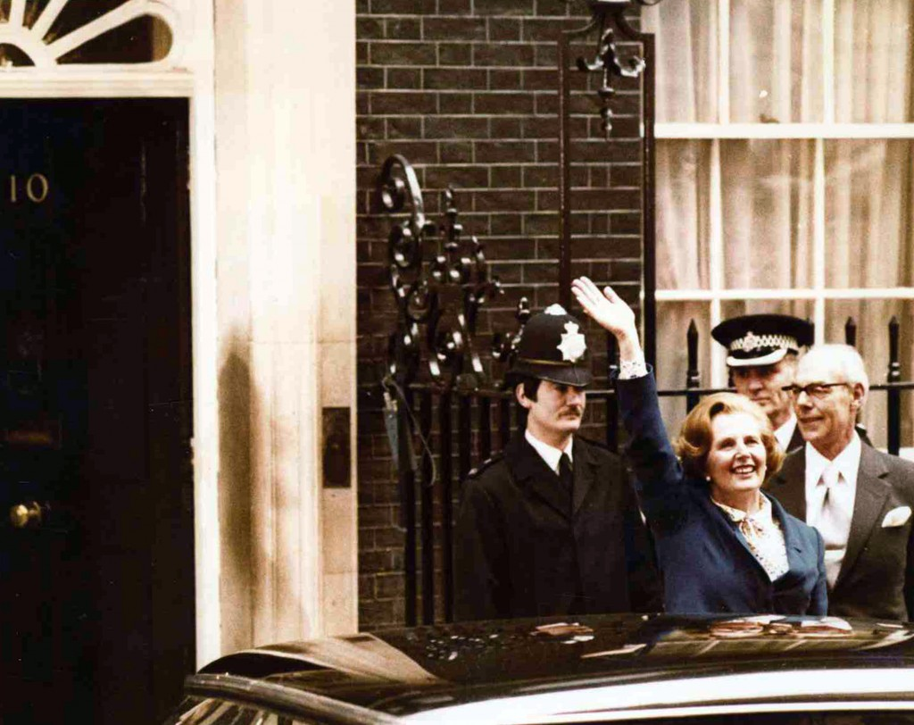 FILE - In this May 4, 1979 file photo, Britain's Conservative Party leader Margaret Thatcher waves to wellwishers as she arrives at 10 Downing Street,...