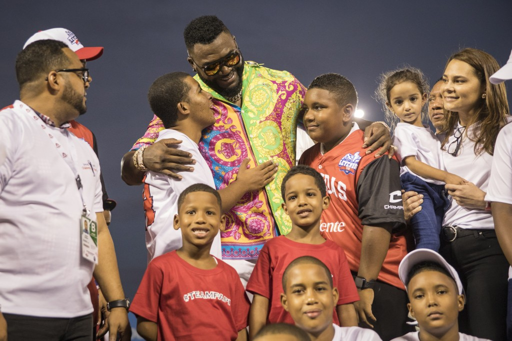 Legendary Boston Red Sox slugger David Ortiz poses for a photo with with youth from the David Ortiz Children's Fund after making a surprise appearance...