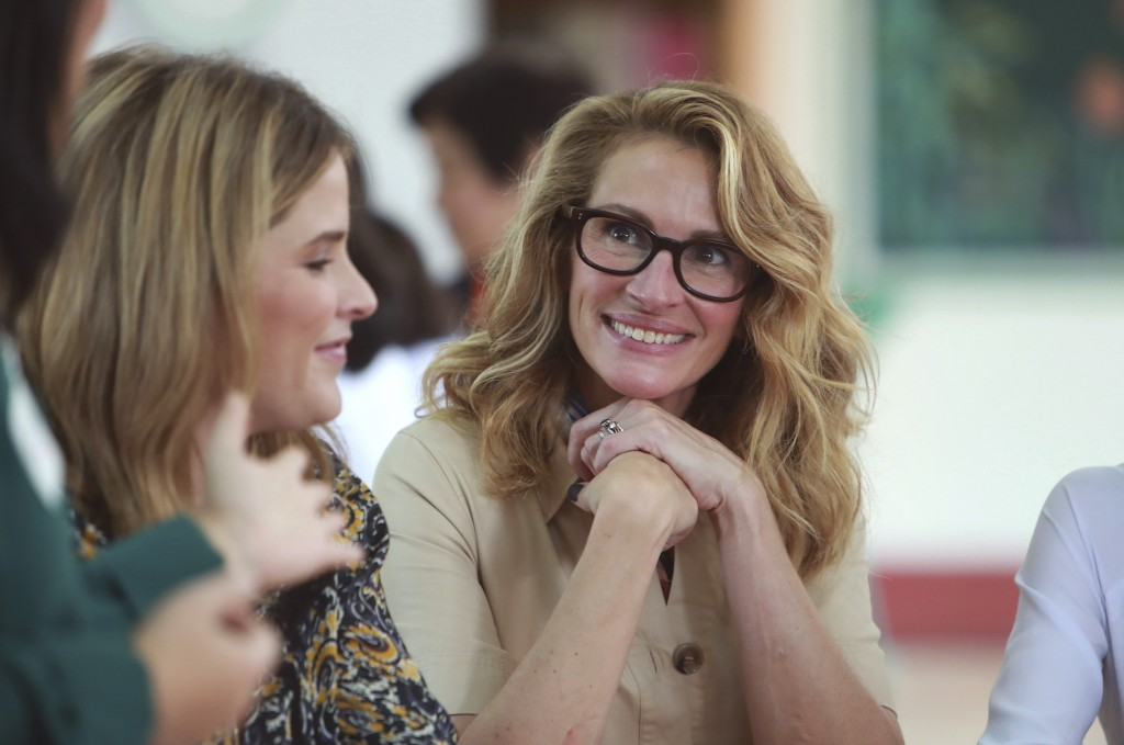 Actress Julia Roberts, right, listens to a students at Can Giuoc high school in Long An province, Vietnam Monday, Dec. 9, 2019. Roberts is accompanyin...