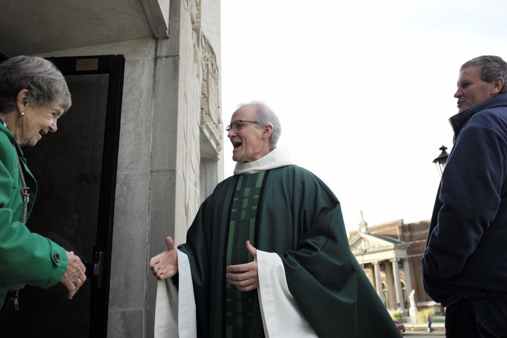 In this Sunday, Oct. 20, 2019 photo, Rev. William Tourigny, 66, center, pastor of St. Rose de Lima Parish, in Chicopee, Mass., greets parishioners fol...