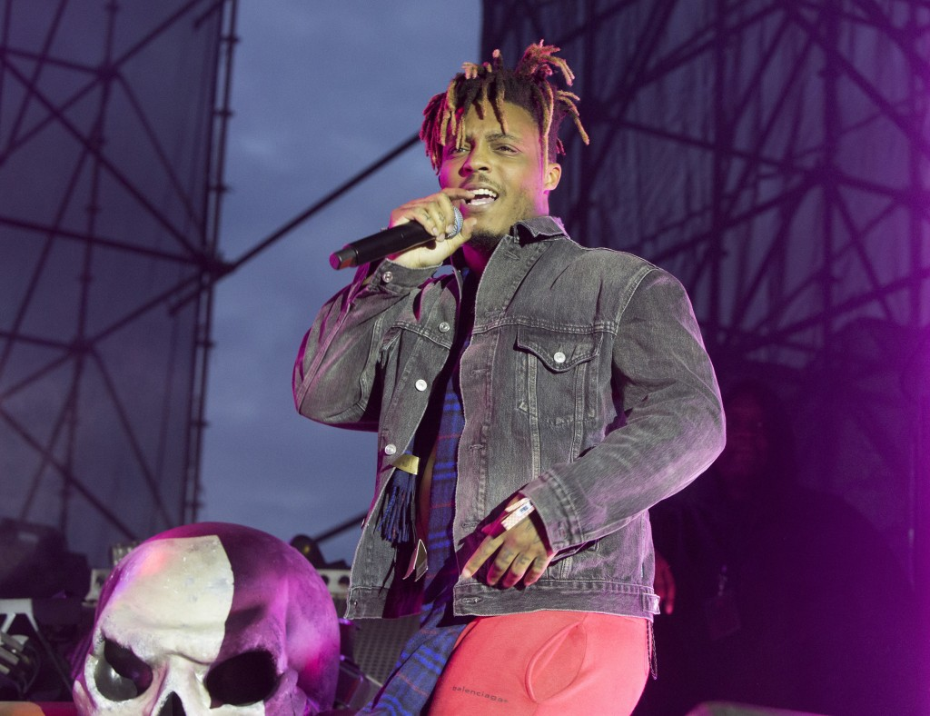 "FILE - In this May 15, 2019 file photo, Juice WRLD performs in concert during his ""Death Race for Love Tour"" at The Skyline Stage at The Mann Center f..."