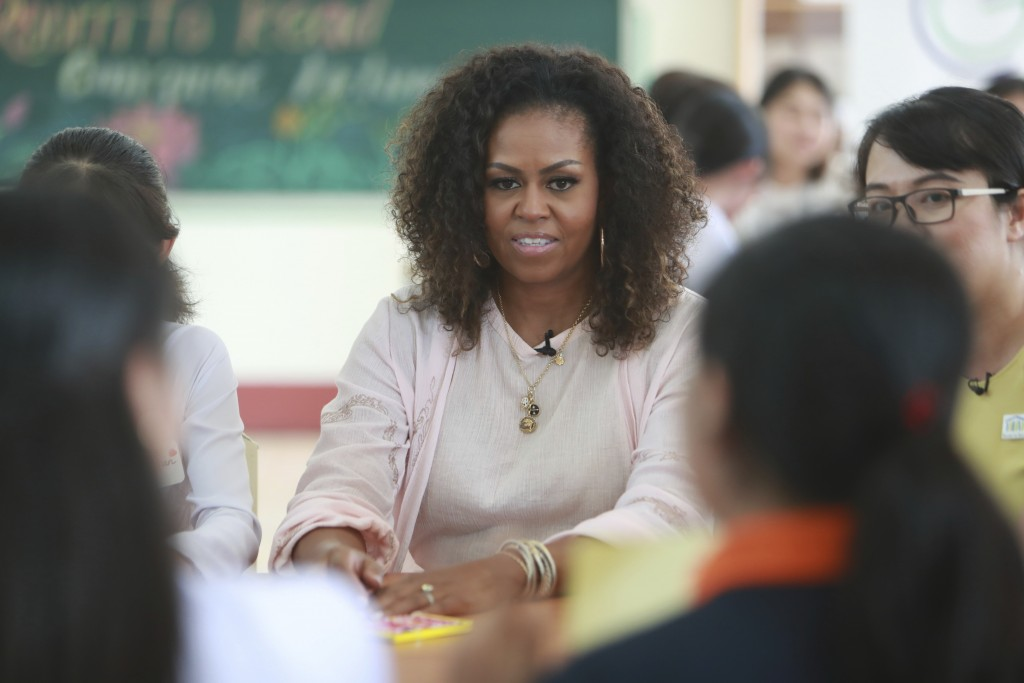 Former U.S. first lady Michelle Obama listens to female students at the Can Giuoc high school in Long An province, Vietnam, Monday, Dec. 9, 2019. Mrs....