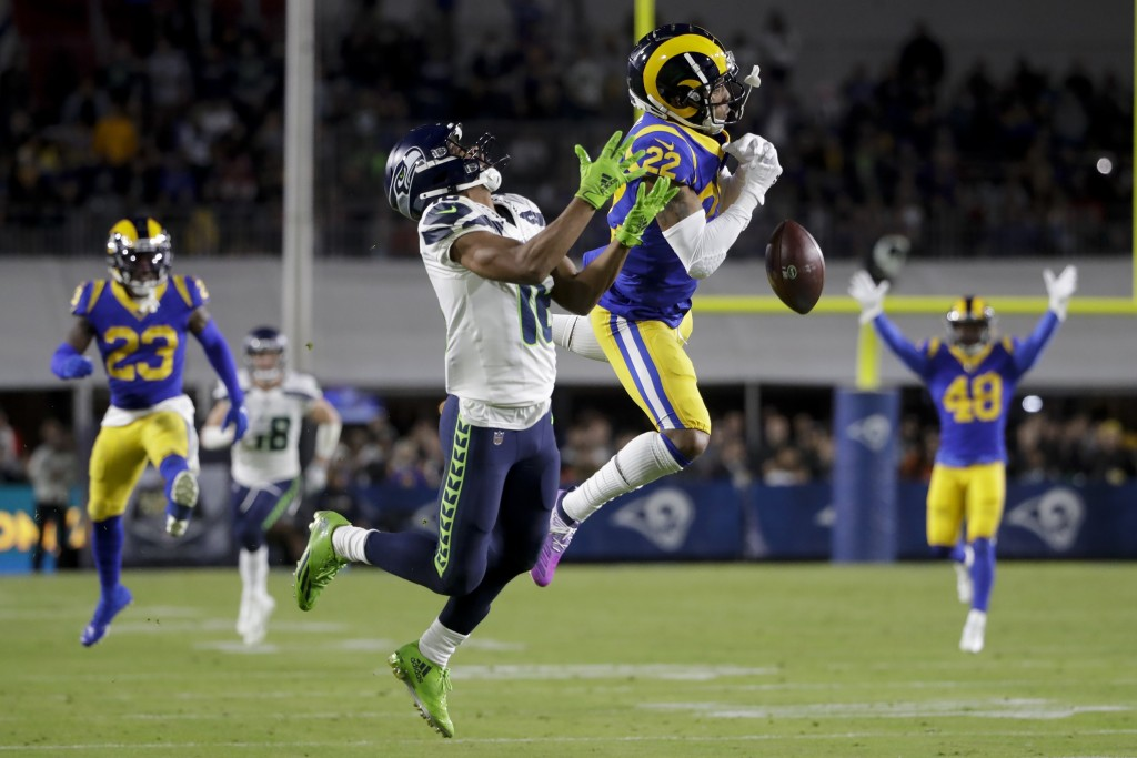 Los Angeles Rams cornerback Troy Hill breaks up a pass intended for Seattle Seahawks wide receiver Tyler Lockett during the first half of an NFL footb...