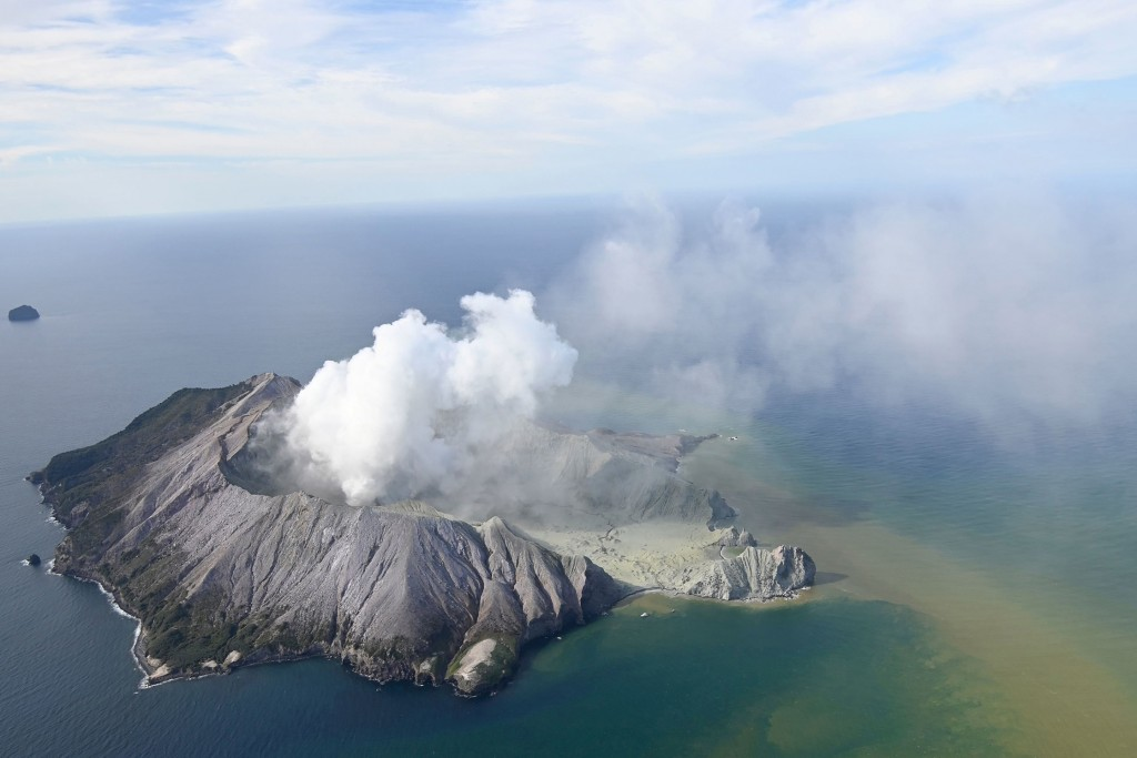 This aerial photo shows White Island after its volcanic eruption in New Zealand Monday, Dec. 9, 2019. The volcano on a small New Zealand island freque...