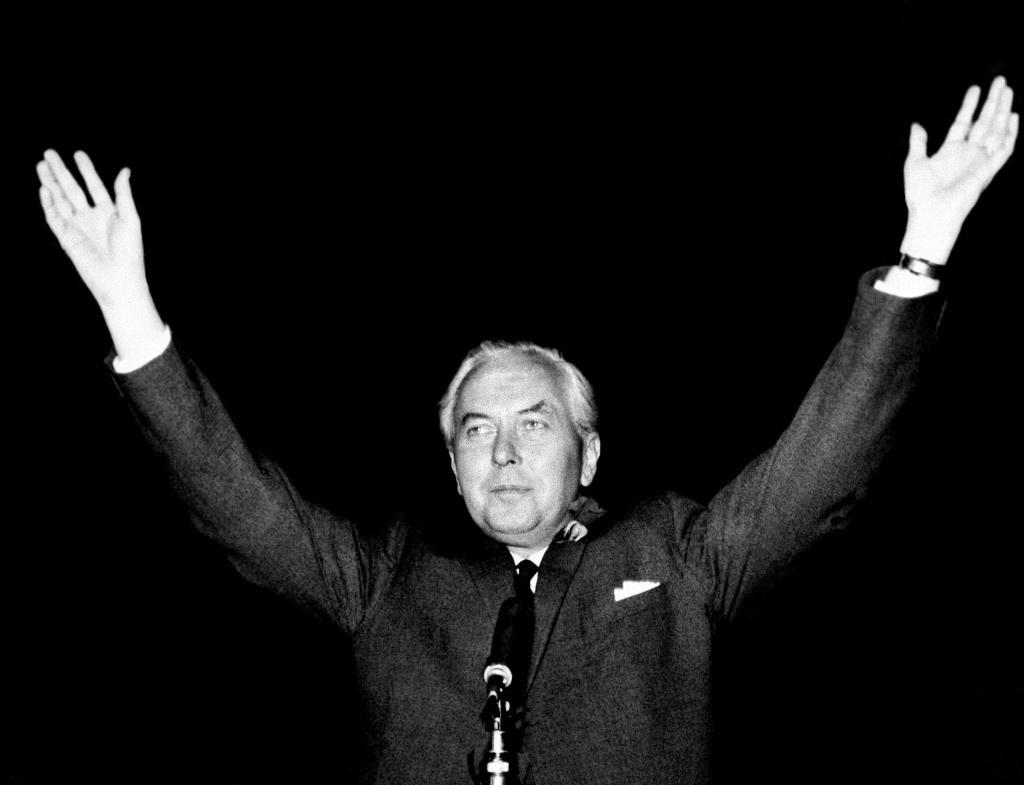 FILE - In this Oct. 15, 1964 file photo, Britain's Labour Party leader Harold Wilson raises his hands after retaining his parliamentary seat in Huyton...