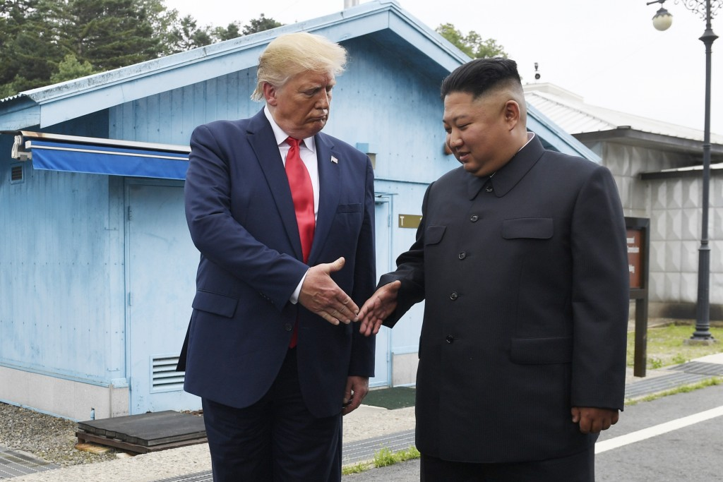 CORRECTS TO REMOVE INCORRECT QUOTE FROM TWEET - FILE - In this June 30, 2019, file photo, U.S. President Donald Trump meets with North Korean leader K...