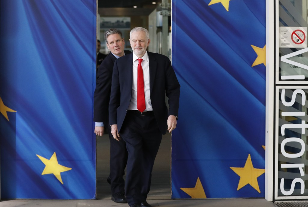 FILE - In this Thursday, March 21, 2019 file photo British Labour Party leader Jeremy Corbyn, right, and Keir Starmer, Labour Shadow Brexit secretary,...
