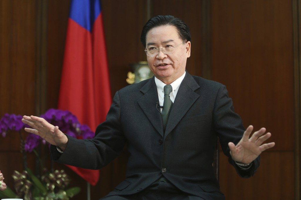 Taiwanese Foreign Minister Joseph Wu gestures while speaking during an exclusive interview with The Associated Press at his ministry in Taipei, Taiwan...