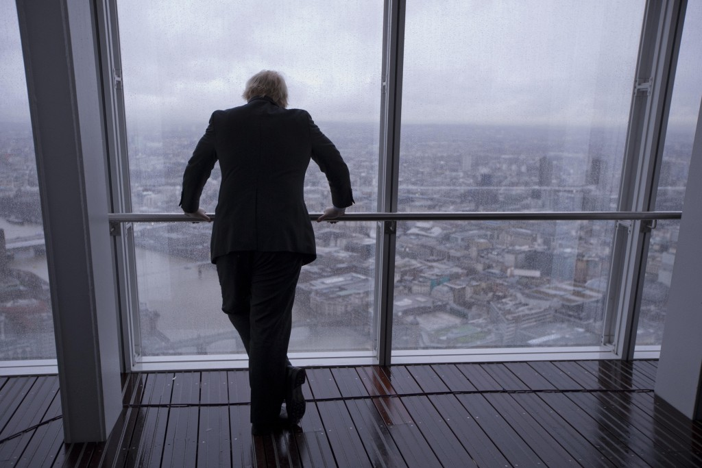 FILE - In this Friday, Feb. 1, 2013 file photo then London mayor Boris Johnson poses for photographers by looking out at the sights after officially o...