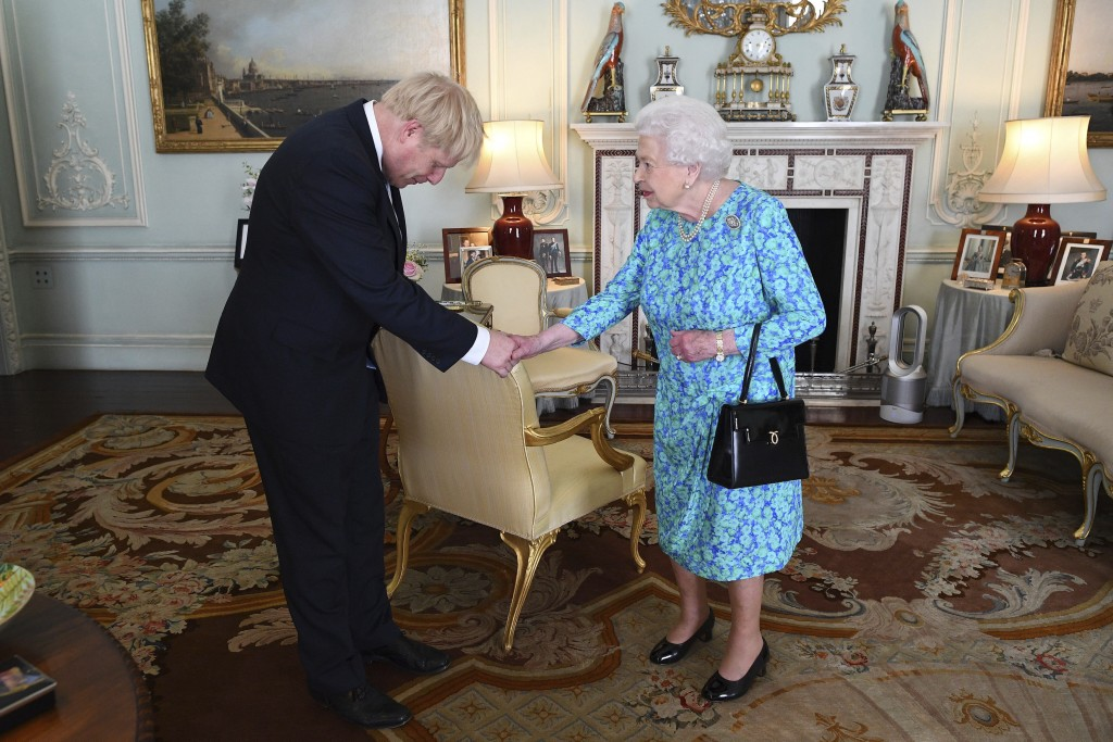 FILE - In this Wednesday July 24, 2019 file photo Britain's Queen Elizabeth II welcomes newly elected leader of the Conservative party Boris Johnson d...