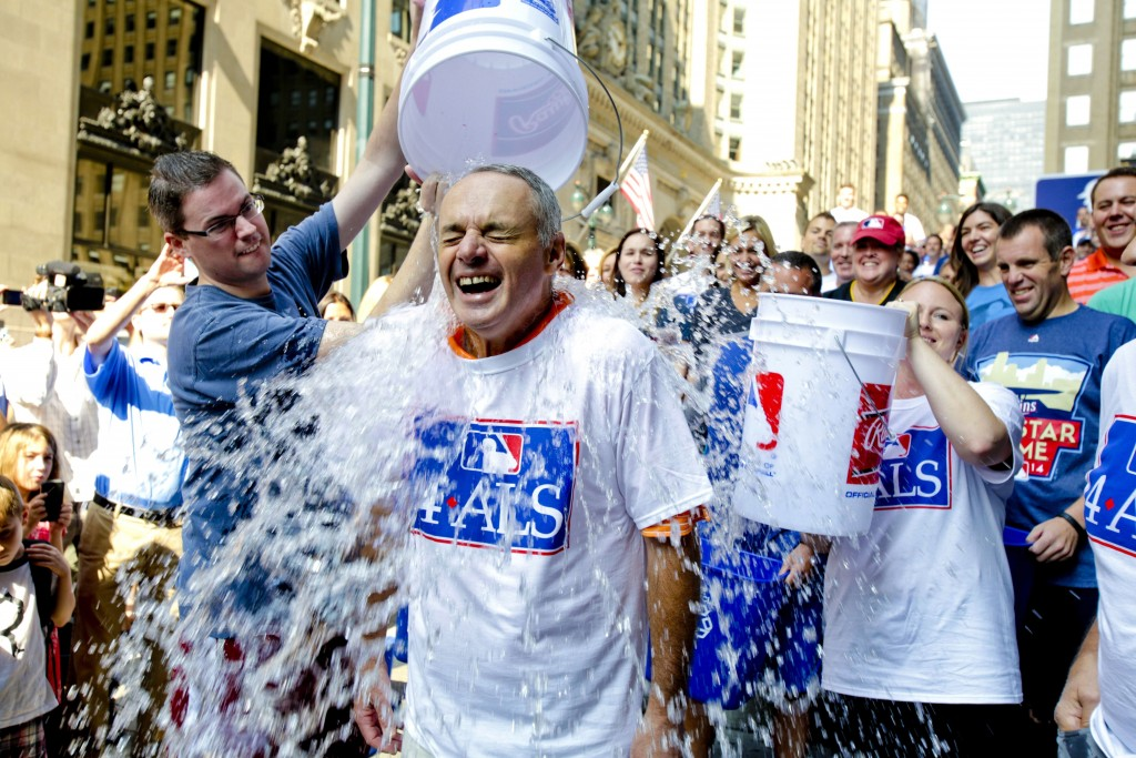 FILE - In this Aug. 20, 2014 file photo, Major League Baseball Commissioner-elect Rob Manfred participates in the ALS Ice-Bucket Challenge outside the...