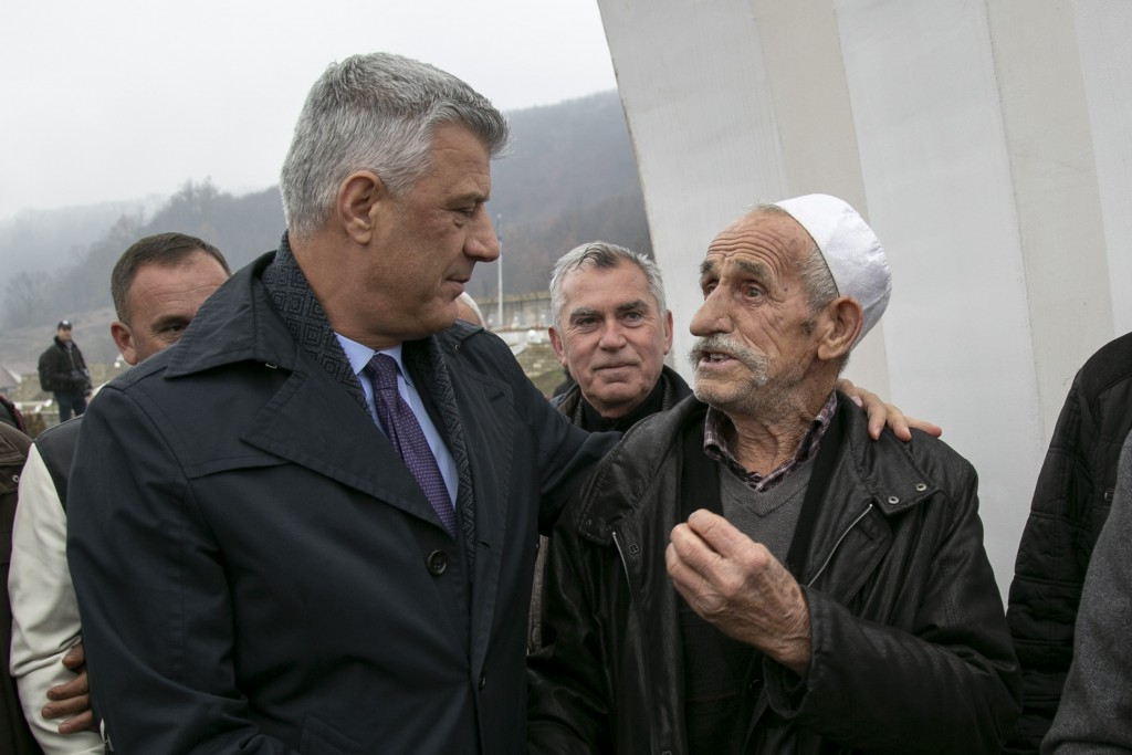 Kosovo president Hashim Thaci, comforts Hafiz Musafaj, during his visit to the Recak memorial, in the village of Recak on Tuesday, Dec. 10, 2019, wher...