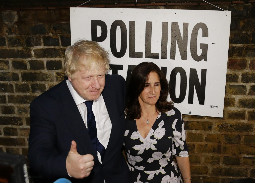 FILE - In this Thursday, June 23, 2016 file photo, British MP Boris Johnson and his wife Marina are photographed as they leave after voting in the EU ...