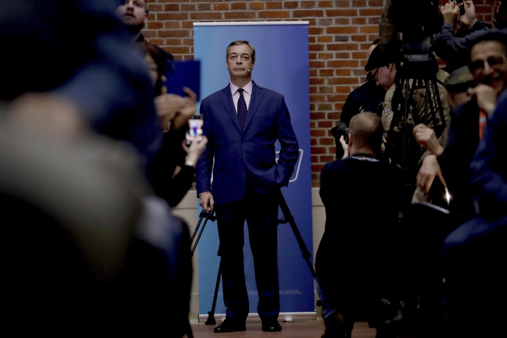 Nigel Farage the leader of the Brexit Party stands at the back of the room as he waits to walk down to the podium to speak during an election press co...