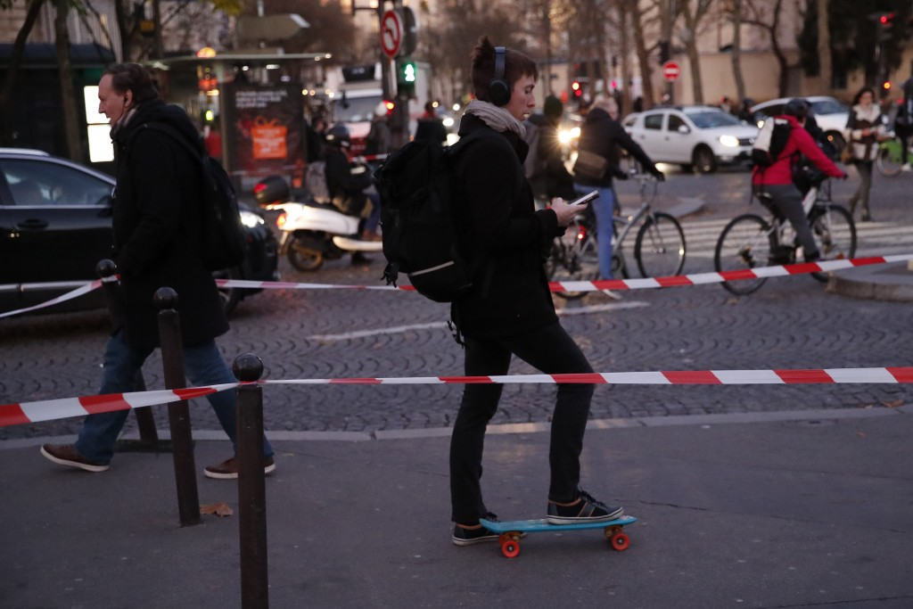 Parisians walk, ride bicycles or a skate board Tuesday, Dec. 10, 2019 in Paris. Only about a fifth of French trains ran normally Tuesday, frustrating ...